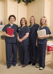 Cosmetic surgery nurses in scrubs